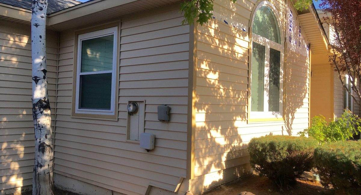 Siding channels around electrical box and sprinkler control boxes.